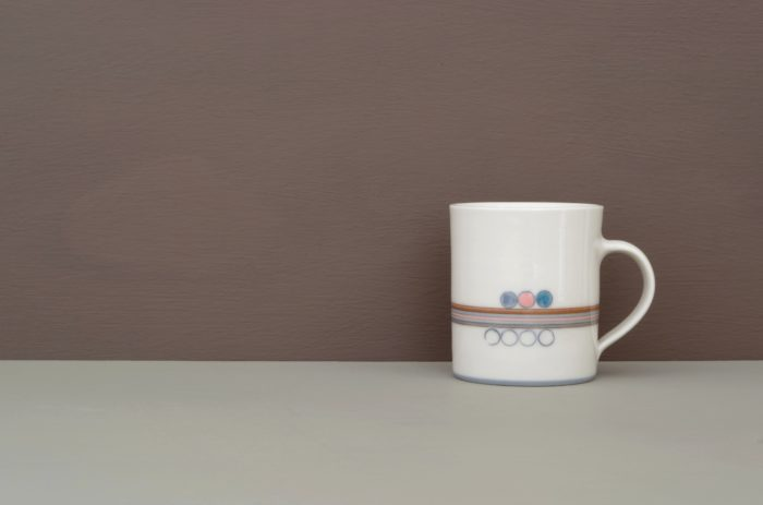 coffee cup thrown porcelain decorated by James and Tilla Waters