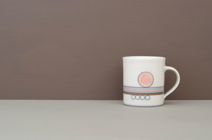 thrown porcelain coffee cup with pink circle by James and Tilla Waters