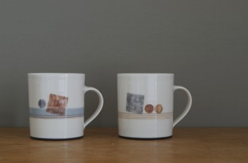 thrown porcelain coffee cups decorated with squares and circles by James and Tilla Waters