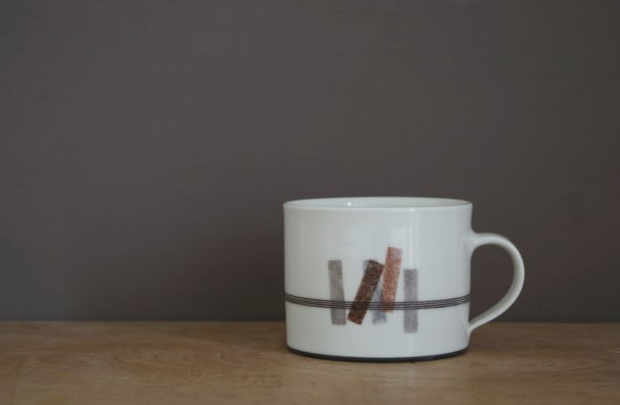 thrown porcelain breakfast mug with rectangles decoration by James and Tilla Waters