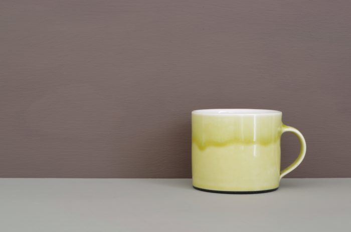 thrown porcelain low coffee cup with sap green glaze by James and Tilla Waters