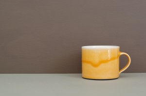 orange low coffee cup by James and Tilla Waters