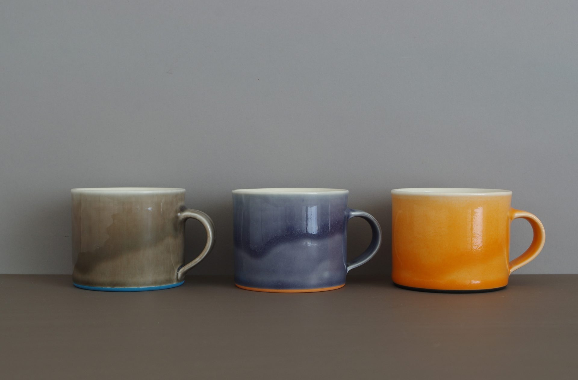 pond slate and orange coffee cups by James and Tilla Waters