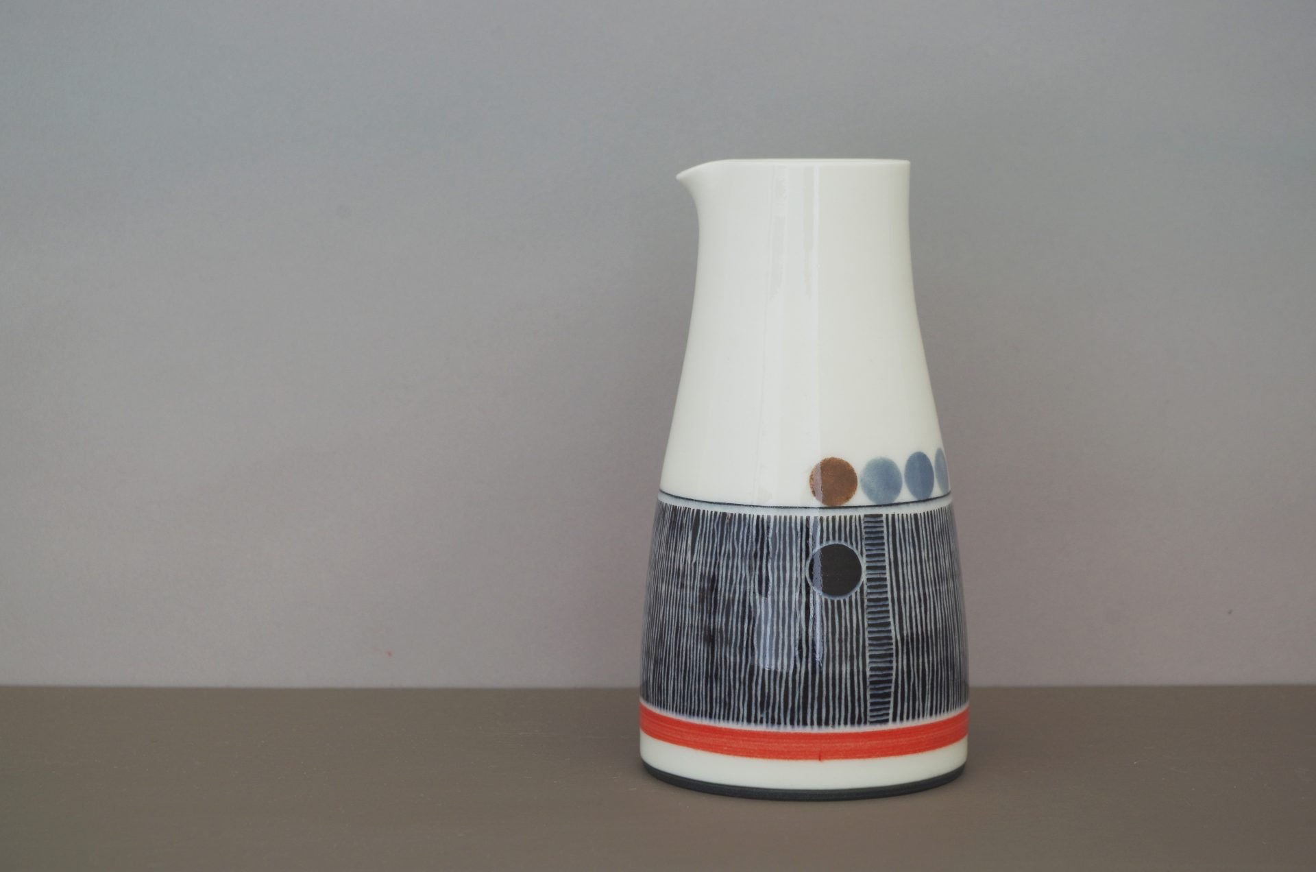 large decorated pourer by James and Tilla Waters