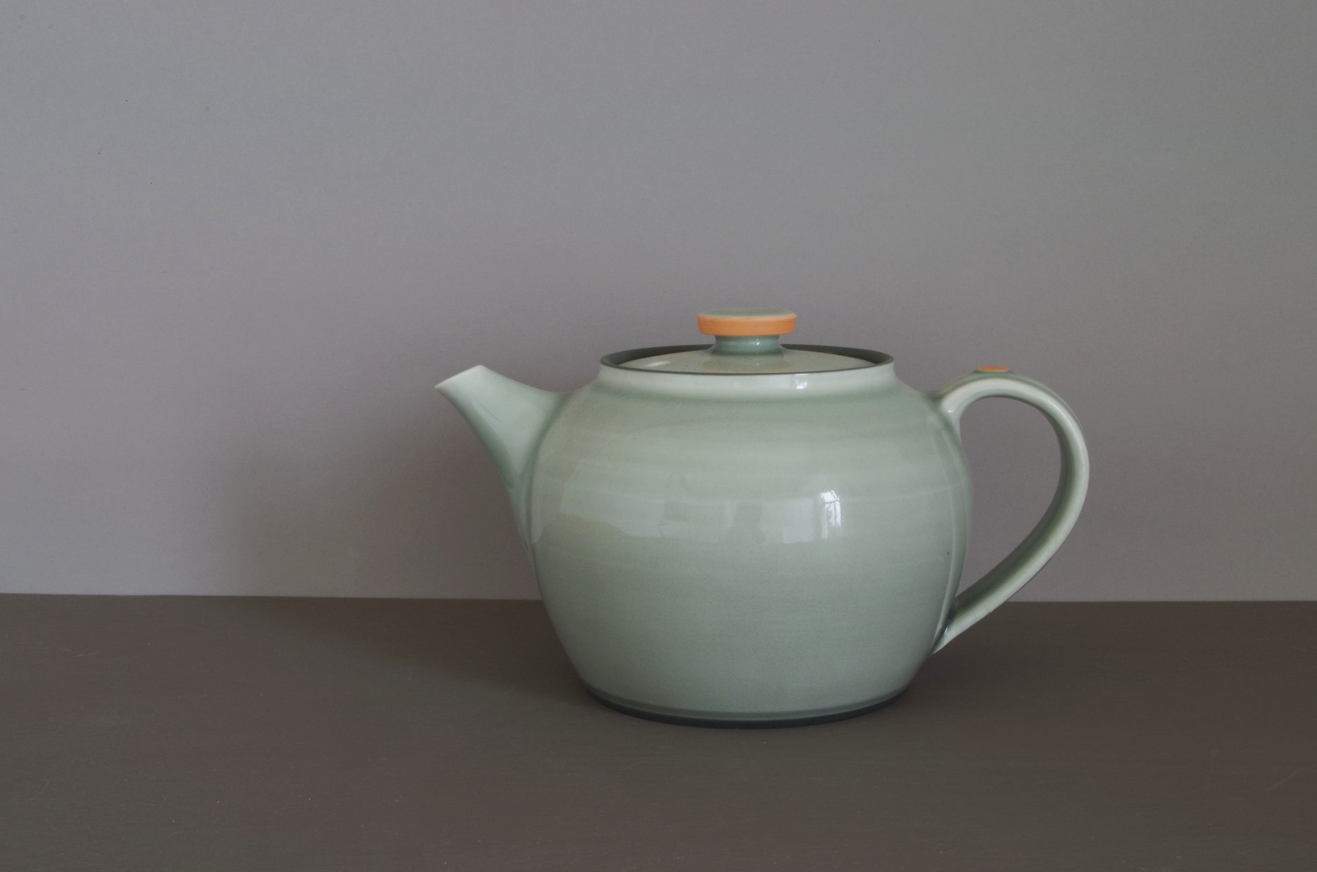 grey/orange teapot by James and Tilla Waters