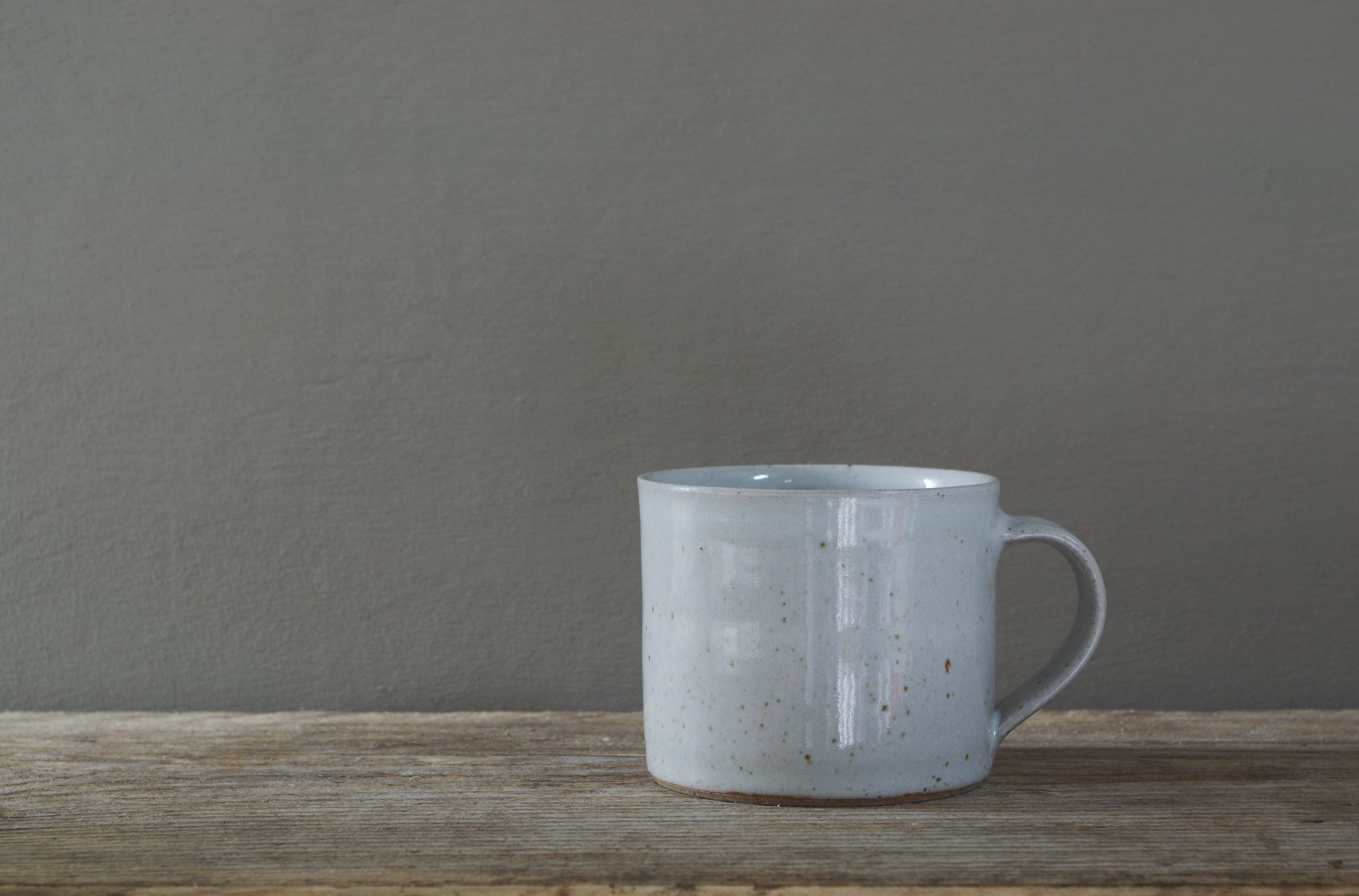white low coffee cup by James and Tilla Waters