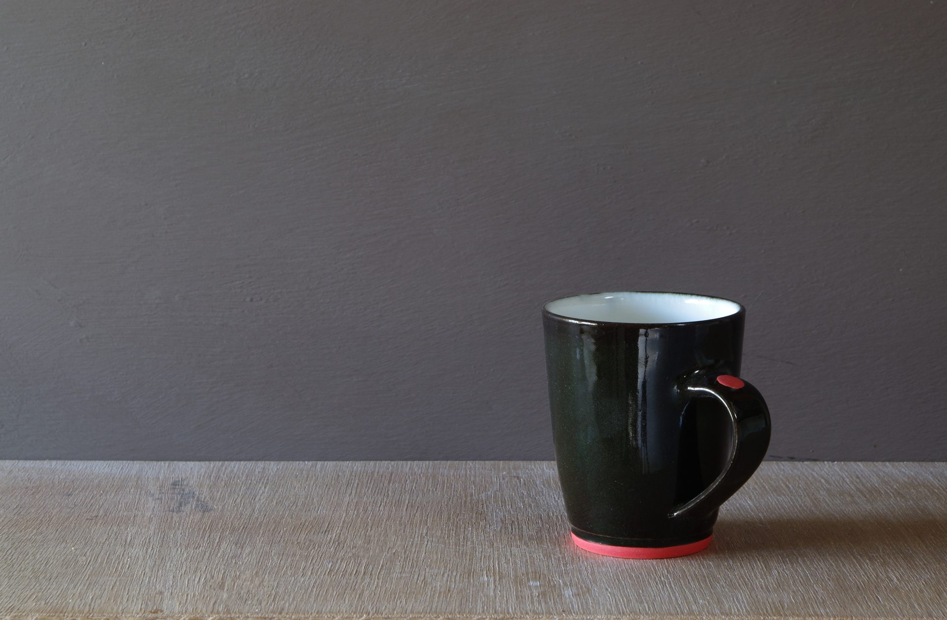 black porcelain coffee cup by James and Tilla Waters