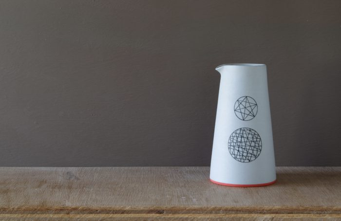 large unglazed pourer with circle decoration by James and Tilla Waters