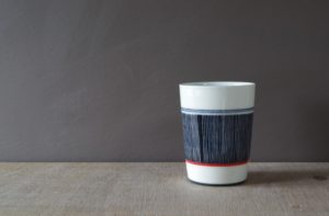 decorated porcelain beaker by James and Tilla Waters