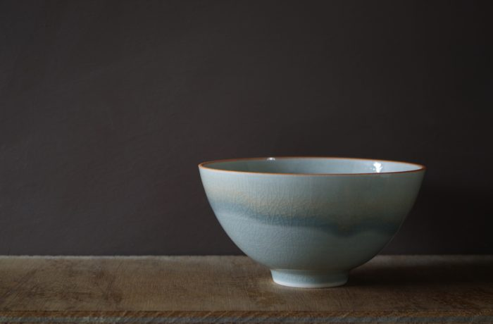 orange rim bowl by James and Tilla Waters