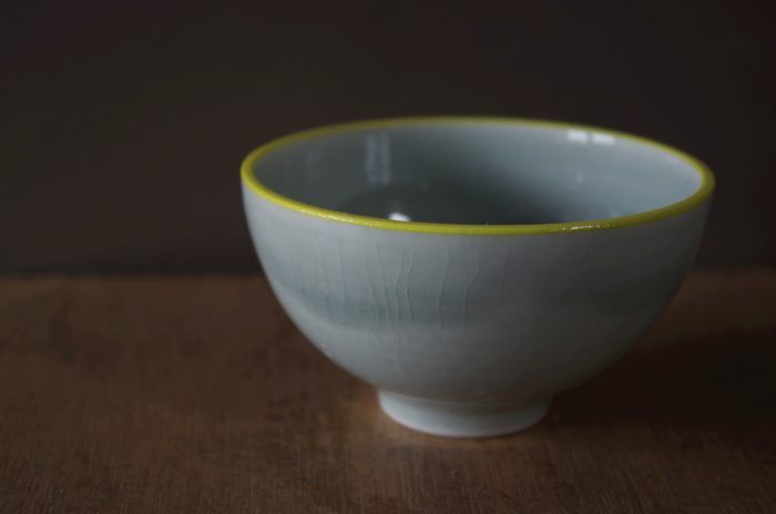 yellow rim bowl by James and Tilla Waters