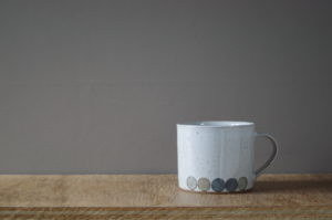 thrown stoneware decorated coffee cup by James and Tilla Waters